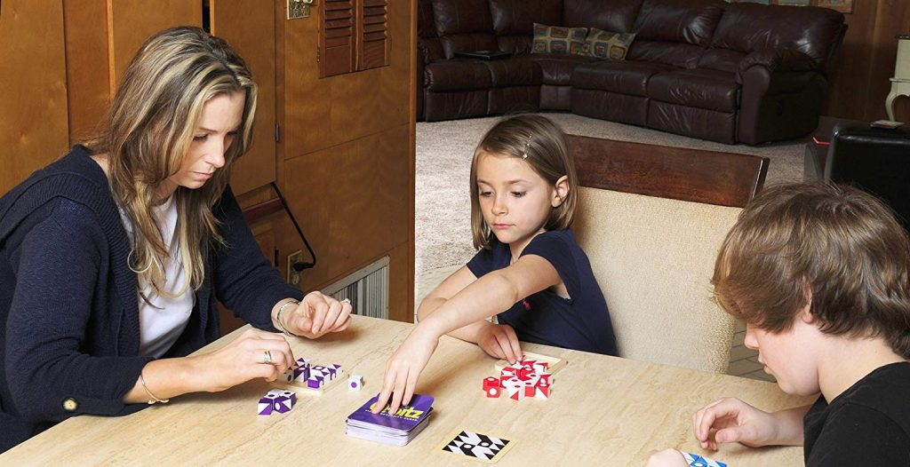 family playing STEM board games